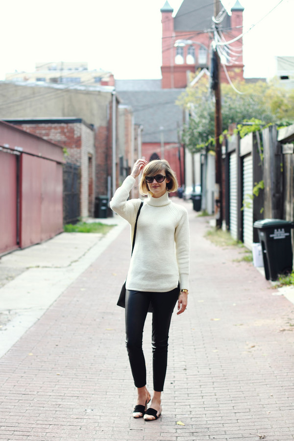 district of chic blogger sunglasses jewels bag black and white turtleneck white turtleneck top black sunglasses black leather pants leather pants black pants black bag