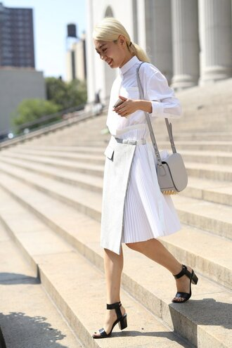skirt office outfits white skirt pleated skirt shirt white shirt sandals black sandals bag grey bag studded bag