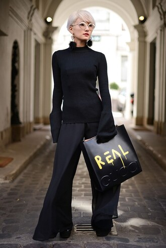 top fashion week 2016 fashion week paris fashion week 2016 black top ribbed top long sleeves bell sleeves pants black pants wide-leg pants bag gucci gucci bag customized black bag earrings glasses all black everything handbag streetstyle bell sleeve sweater