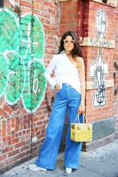 le fashion,blogger,sunglasses,shirt,bag,jeans,shoes,one shoulder,white top,long sleeves,high waist pants,high waisted jeans,wide-leg pants,white sneakers