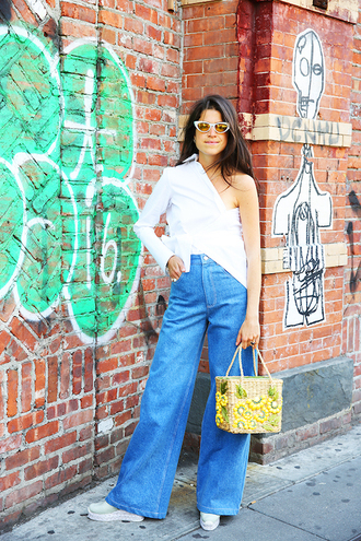 le fashion blogger sunglasses shirt bag jeans shoes one shoulder white top long sleeves high waist pants high waisted jeans wide-leg pants white sneakers
