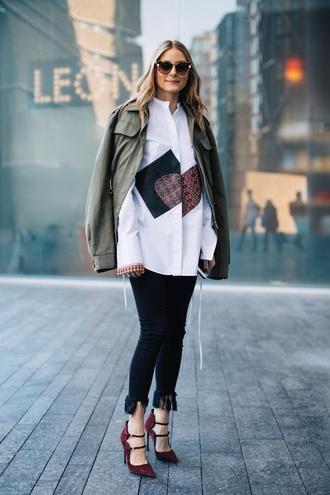 jeans london fashion week 2017 fashion week 2017 fashion week streetstyle black jacket skinny jeans frayed denim frayed jeans white shirt shirt jacket army green jacket green bomber jacket khaki bomber jacket bomber jacket shoes red shoes high heels heels sunglasses olivia palermo