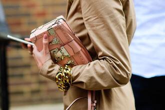 bag fashion week street style fashion week 2016 fashion week bracelets pink bag structured clutch coat camel coat trench coat streetstyle london fashion week 2016
