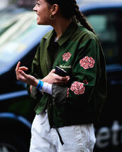 jacket,tumblr,army green jacket,bomber jacket,green bomber jacket,embroidered,embroidered jacket,pants,white pants,earrings,fashion week 2017,streetstyle,flowers,roses,rose embroidered