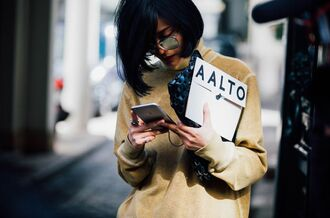 top fashion week street style fashion week 2016 fashion week paris fashion week 2016 nude top long sleeves yellow bag pouch black bag sunglasses mirrored sunglasses streetstyle