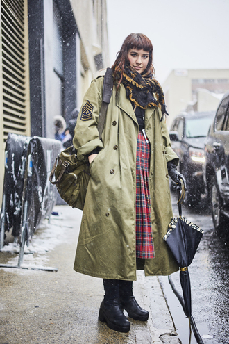 coat nyfw 2017 fashion week 2017 fashion week streetstyle oversized oversized coat trench coat green coat masculine coat skirt midi skirt pleated pleated skirt tartan plaid skirt tartan skirt boots black boots backpack scarf winter outfits winter look