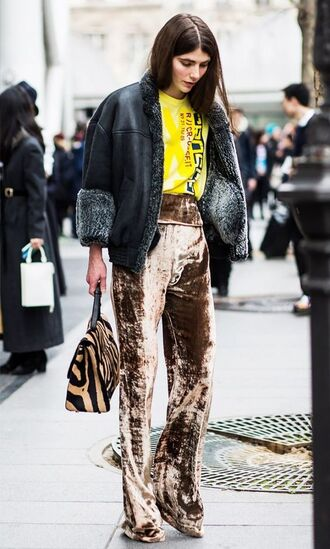 pants wide-leg velvet pants brown nude pants wide-leg pants velvet velvet pants top yellow yellow top jacket shearling jacket black shearling jacket black jacket bag animal print bag animal print streetstyle fall outfits