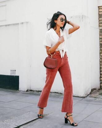 pants pink pants flare pants shirt white top top white crop tops crop tops tie-front top sandals sandal heels mid heel sandals bag handbag