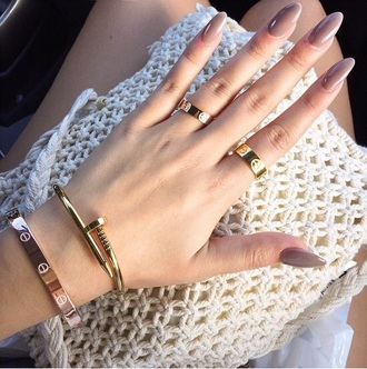 nail accessories bracelets ring gold ring gold bracelet coat jewels accessories cartier nails luxury love hammer jewelry stacked jewelry stacked bracelets arm candy designer inspired look for less gold tumblr fashion summer