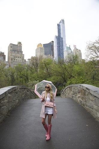 atlantic pacific blogger pink coat chanel bag white top white shorts boots umbrella