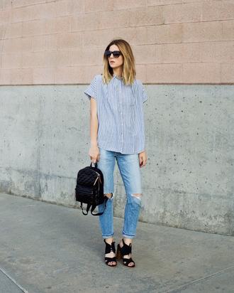 blogger shoes sunglasses ripped jeans skinny jeans black backpack black bag striped top black heels back to school striped shirt blue jeans block heels stacked wood heels stripe shirt mini backpack