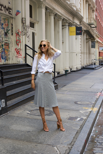 mind body swag blogger sunglasses bag jewels white blouse button up grey skirt thick heel lace up heels round sunglasses caged sandals