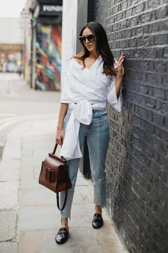 shirt tumblr white wrap top asymmetrical asymmetrical top asymmetric shirt jeans denim blue jeans cropped jeans bag brown bag shoes black shoes loafers black loafers sunglasses