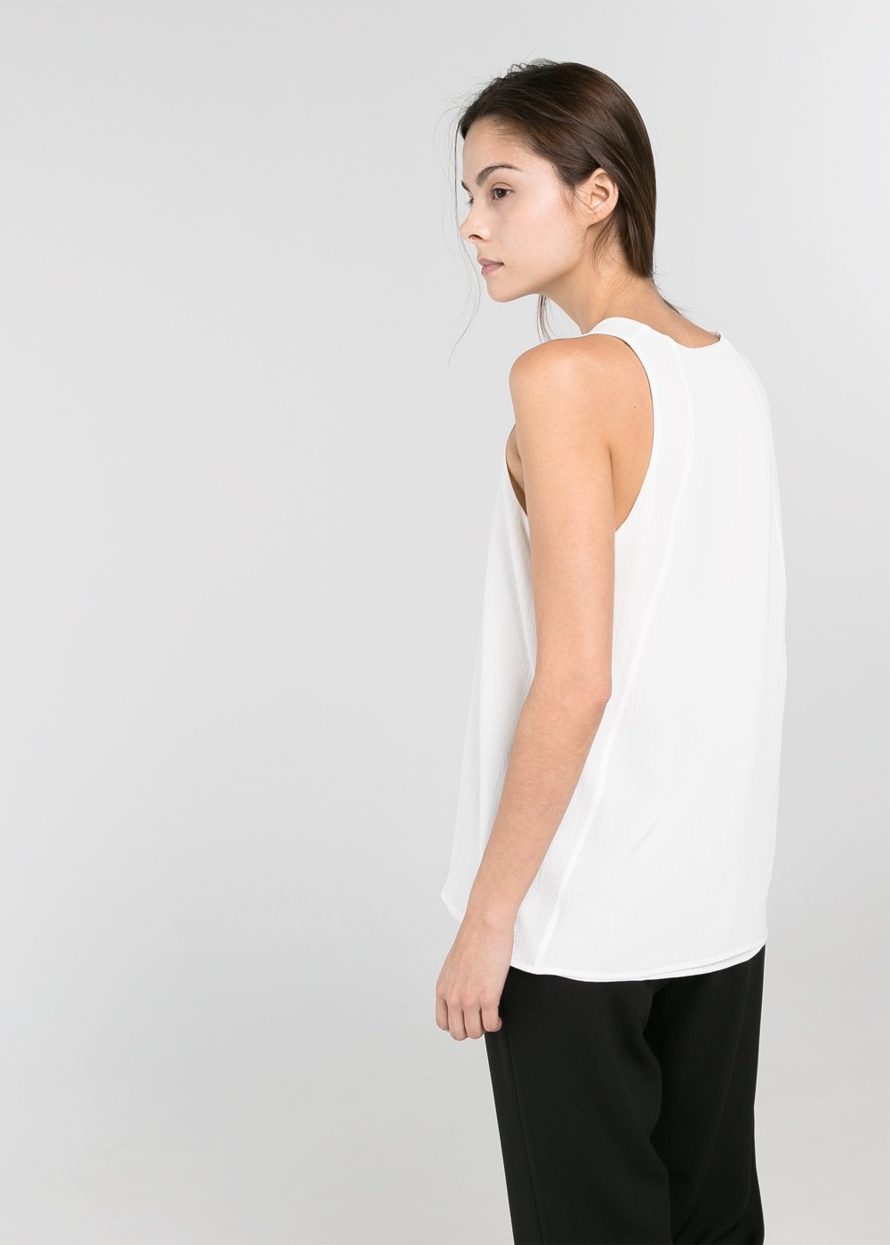 Textured v-neck top -    Women - MANGO