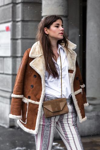 the fashion fraction blogger 70s style shearling jacket striped pants printed pants suede bag brown bag winter jacket brown shearling jacket white shirt shirt bag crossbody bag camel shearling coat