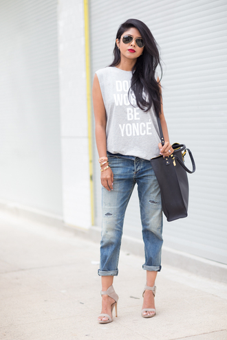 walk in wonderland bag jewels denim sandals high heels aviator sunglasses summer outfits bracelets quote on it slogan t-shirts graphic tee top jeans shoes ripped jeans grey top cropped jeans grey heels stilettos blogger