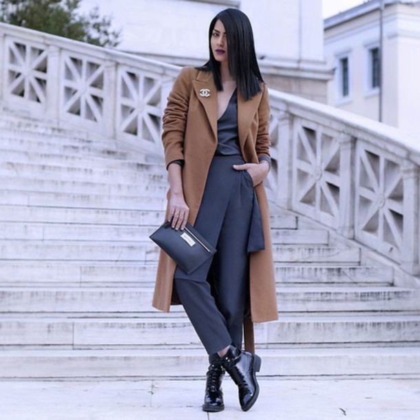 coat black outfit clutch straight hair classy style date outfit boots shiny jewels brooch chanel brooch brown coat long coat chanel pants grey pants top grey top v neck bag black bag black boots flat boots fall outfits