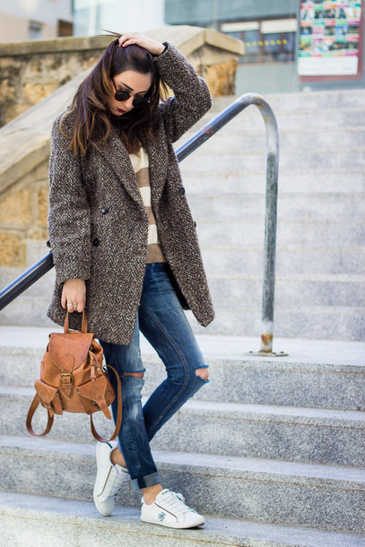 shoes and basics blogger jeans winter coat leather backpack striped sweater mini backpack winter outfits ripped jeans blue jeans white sneakers masculine coat