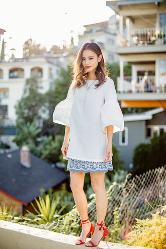 cardigan sandals skirt jamie chung spring outfits mini skirt tunic blogger shoes red heels white blouse bell sleeves blue dress bell sleeve top