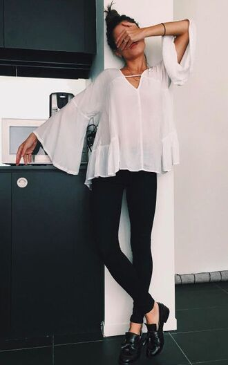 blouse white blouse flowy blouse sheer top black jeans black shoes messy bun boho top bell sleeves loose top white black cupboard tile floor