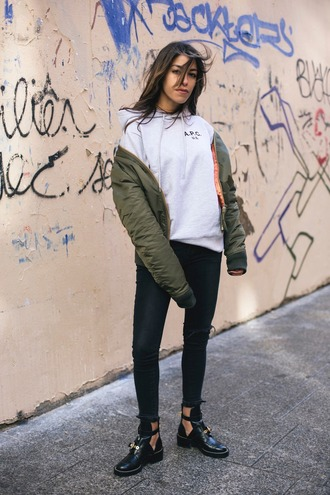 fadela mecheri blogger sweater jeans shoes hoodie cut out ankle boots bomber jacket khaki bomber jacket skinny jeans