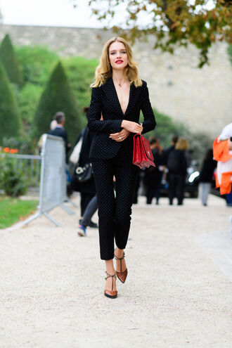 pants fashion week street style fashion week 2016 fashion week paris fashion week 2016 black pants black blazer blazer power suit two piece pantsuits polka dots bag matching set red bag shoes brown shoes high heels pointed toe natalia vodianova model streetstyle plunge v neck v neck