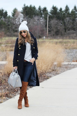 lilly's style blogger coat sweater jeans shoes bag hat belt sunglasses jewels winter outfits beanie handbag black coat knee high boots brown boots grey bag