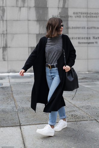 viennawedekind blogger cardigan t-shirt jeans belt bag socks shoes black coat bucket bag sneakers skinny jeans winter outfits