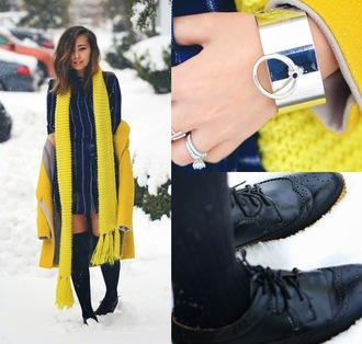 different cands blogger silver jewelry bracelets black shoes oxfords striped dress winter dress yellow coat knitted scarf yellow winter outfits dress shoes jewels