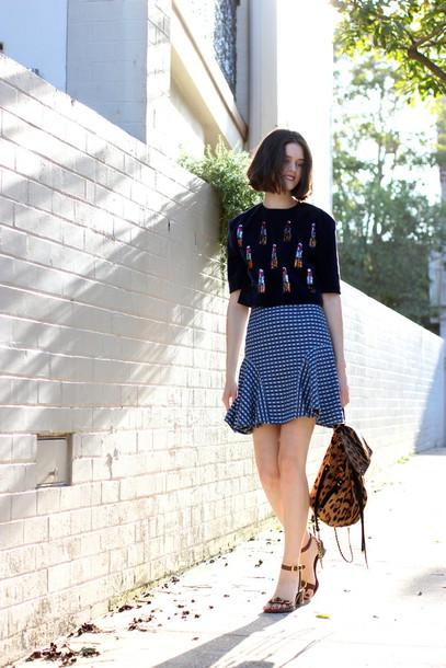 by chill blogger black t-shirt ruffle backpack animal print sandals blue skirt animal print bag