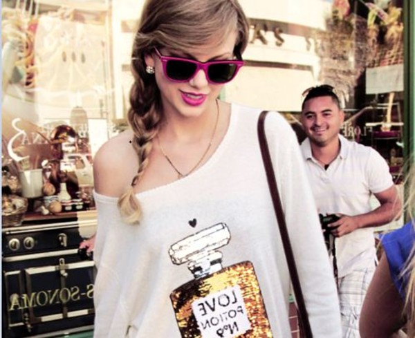 taylor swift white shirt orange shirt perfume chanel shirt