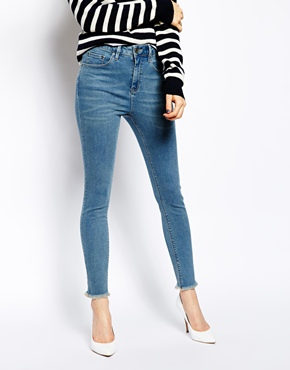 ASOS | ASOS Ridley High Waist Ultra Skinny Ankle Grazer Jeans in Rosebowl Mid Wash Blue with Raw Hem at ASOS