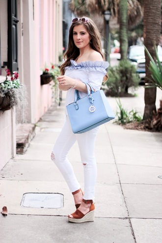 thedaintydarling blogger top jeans shoes bag jewels sunglasses off the shoulder top handbag blue bag wedges white pants