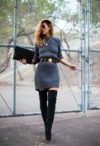 blogger sunglasses belt sweater dress pouch thigh high boots winter outfits knitted dress jewels dress bag shoes double buckle belt grey dress ribbed dress long sleeves winter dress over the knee boots over the knee clutch givenchy bag givenchy black belt knitted mini dress grey sweater dress grey knitted dress grey knit dress mini knit dress mini knitted dress