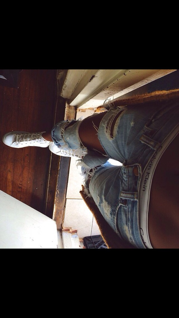 jeans top pants holes wripped washed out cute summer outfits ripped jeans calvin klein underwear white shoes boyfriend jeans underwear calvin klein underwear sneakers low rise style blue jeans light blue jeans light blue