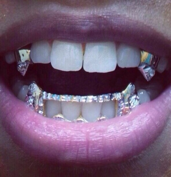 jewels grillz spiked teeth grillz gold vampire teeth bling yonce jourdan dunn grillz gold gotta have it dope style fashion swag dope wishlist grillz fangs diamonds vampire grills where did u get that sparkle diamonds shiny lip make-up make-up mother of pearl silver mouth teeths platinum canine k9 fang grillz diamond grillz vampire grillz teeth grillz gemstone silver jewelry accessories