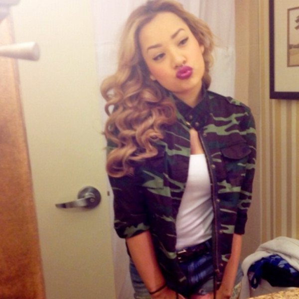 jacket curly hair white tank top high waisted jeans denim jeans camouflage camo jacket