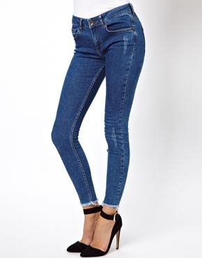 ASOS   ASOS Ripped Raw Hem Skinny Jean at ASOS