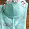 Pastel mint lace crop bustier embellished with small pale pink and white flowers and silver spikes
