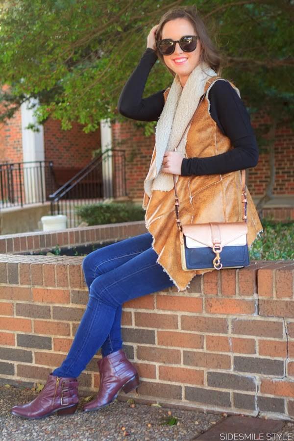 side smile style jacket jeans shoes jewels shearling vest black top sunglasses black sunglasses denim blue jeans skinny jeans bag chelsea boots boots ankle boots