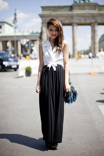 black skirt long sleeves vintage earrings feathers black bag skirt blouse