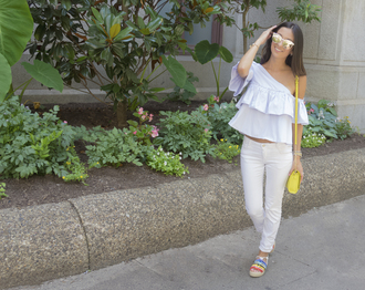 the material girl blogger jeans bag sunglasses shoes one shoulder ruffle ruffled top shoulder bag yellow mini bag white jeans flats mirrored sunglasses blue top yellow bag espadrilles