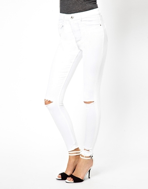 ASOS | ASOS Ridley Supersoft Ankle Grazer in White with Ripped Knees and Raw Hem at ASOS