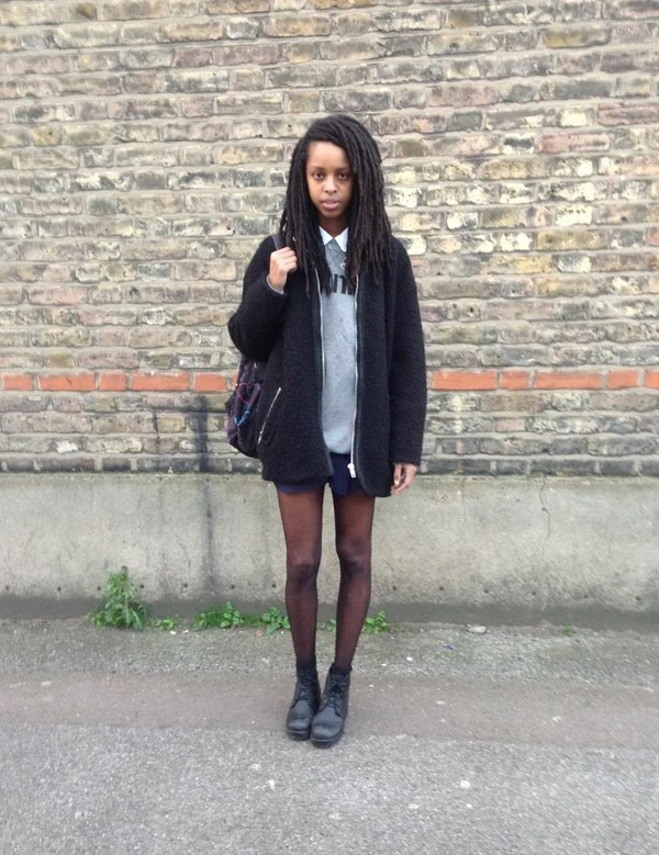 yawn stretch and read sweater shirt skirt shoes coat