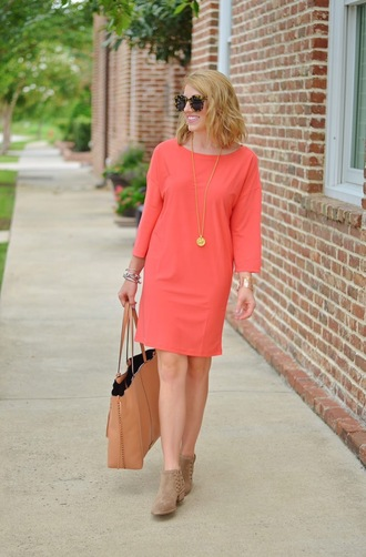 something delightful blogger dress jewels shoes sunglasses bag pink dress red dress light pink salmon brown bag ankle boots nude boots spring dress necklace tortoise shell tortoise shell sunglasses spring outfits boots mid heel boots