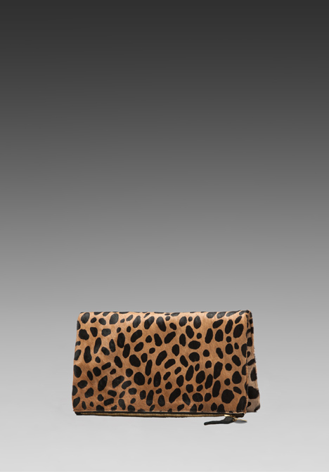 CLARE VIVIER Foldover Clutch in Leopard at Revolve Clothing - Free Shipping!
