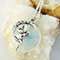 Polished opal moonstone fairy on a crescent moon necklace - faerie pixie circle