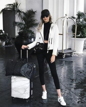 carly cristman blogger jacket top leggings shoes sweater cap white jacket sneakers louis vuitton bag travel bag