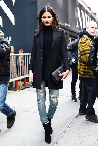 le fashion image blogger jacket sweater bag jeans black blazer ripped jeans yves saint laurent clutch black boots black top black turtleneck top black coat skinny jeans