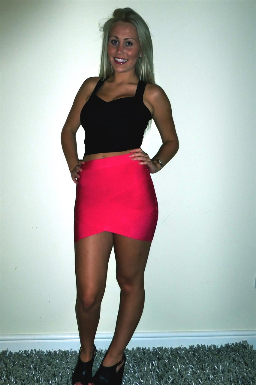 Deja Boutique. Aussie' hot pink v  bandage skirt